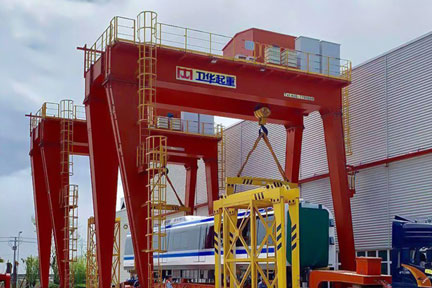 Two Linkage Gantry Cranes with Wireless Communication for Train Handling